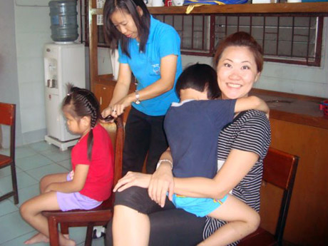 Dec 2011 - Carrying a blind and retarded orphan in Bangkok after flood Oct incident