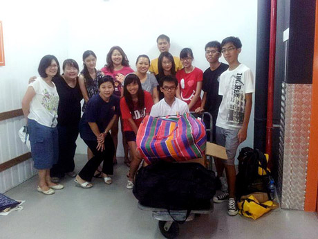 Love Project Dec 2011 - Group photo with volunteers after packing used cloths for Cambodian orphans in Phnom Pehn
